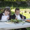 Children eating veg at a table